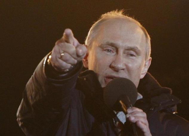 Russia's current PM and presidential candidate Putin addresses supporters during a rally in Manezhnaya Square near the Kremlin in central Moscow